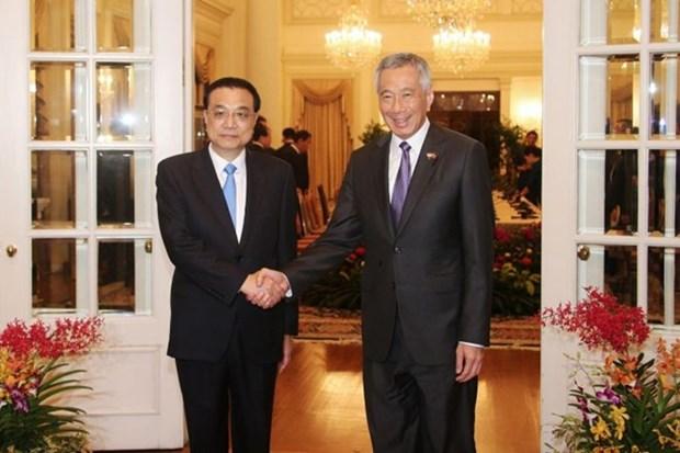 中新两国总理举行会谈 双方签署11项合作备忘录 hinh anh 1