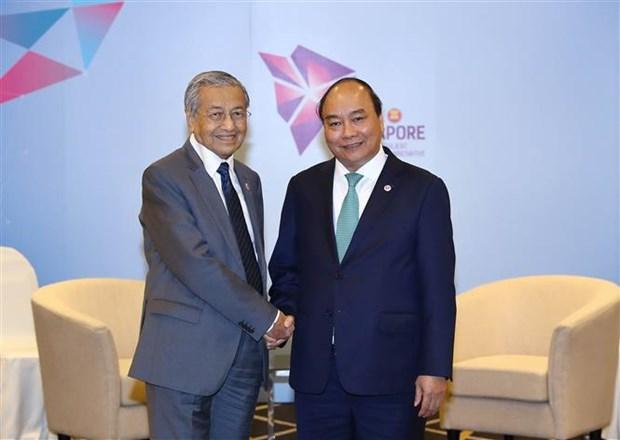 东盟峰会:政府总理阮春福会见文莱和马来西亚领导人 hinh anh 2