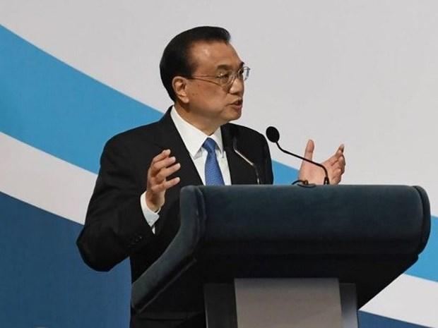 东盟峰会:中国提倡维护亚洲金融稳定的措施 hinh anh 1