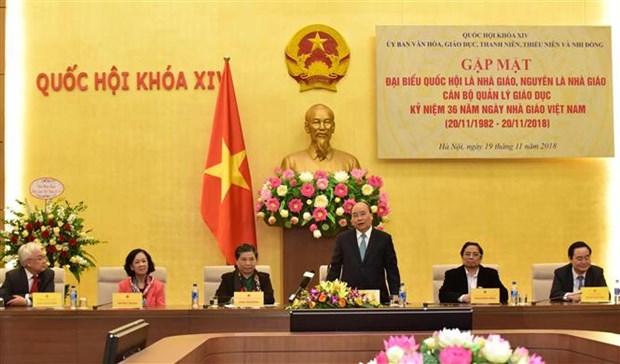 阮春福总理会见优秀教育管理工作者和教师代表 hinh anh 1