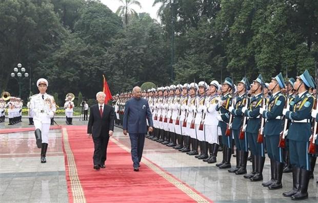 越共中央总书记、国家主席阮富仲为印度总统举行隆重的欢迎仪式 hinh anh 1