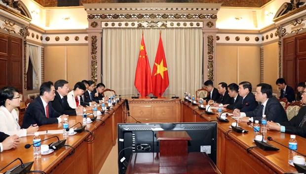 胡志明市人民委员会主席会见中国湖南省省委书记 hinh anh 2