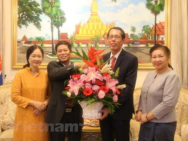 越南驻马来西亚大使馆祝贺老挝国庆43周年 hinh anh 1