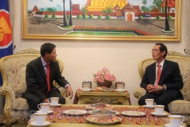 越南驻马来西亚大使馆祝贺老挝国庆43周年 hinh anh 2