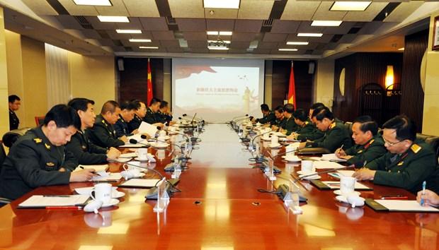 越南人民军总政治局与中共中央军委政治工作部进一步加强合作 hinh anh 1