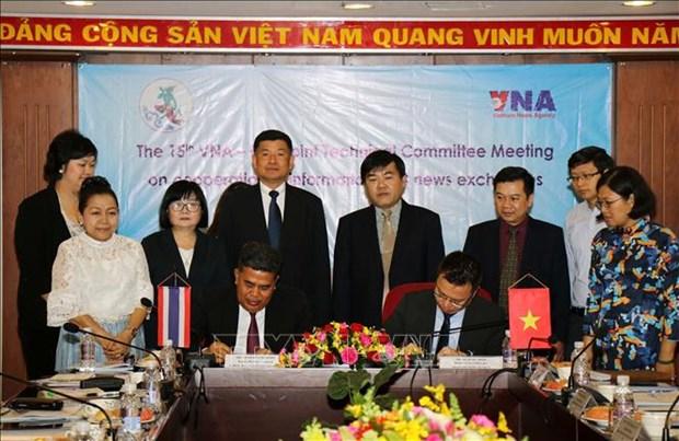 推动越南通讯社与泰国公共关系部的合作走向深入 hinh anh 2