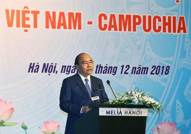 政府总理阮春福与柬埔寨首相洪森出席越柬商业论坛 hinh anh 2