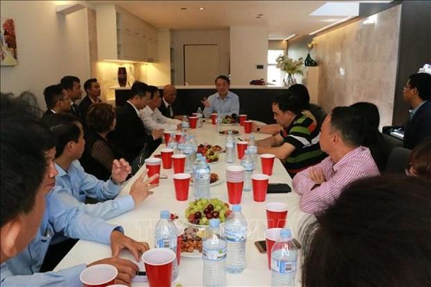 越南祖国阵线中央委员会代表团会见旅澳越南人代表 hinh anh 1