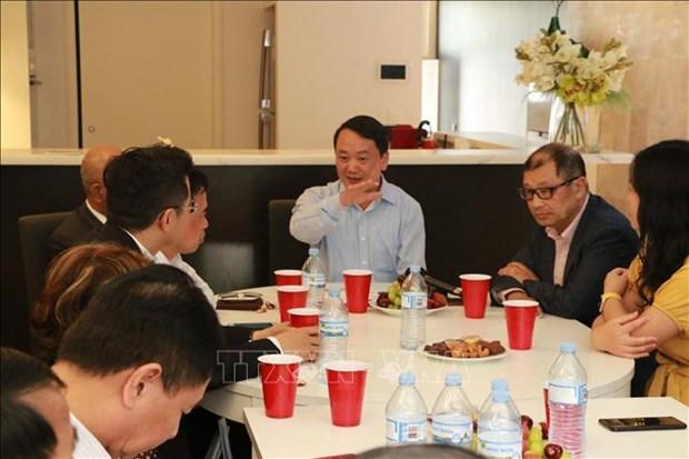 越南祖国阵线中央委员会代表团会见旅澳越南人代表 hinh anh 2