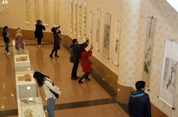 越南与中国共同分享传统舞台艺术发展的经验 hinh anh 2