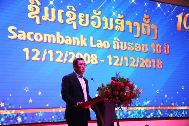 越南银行助力老挝经济社会发展 hinh anh 1
