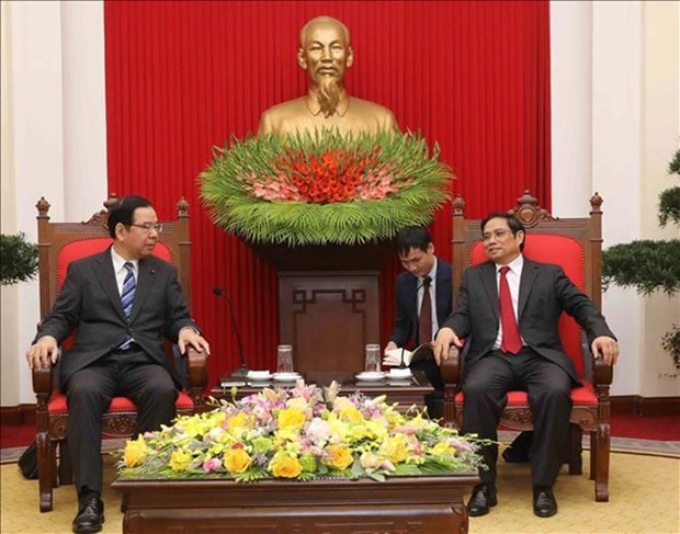 越共中央组织部部长范明正会见日本共产党中央委员会主席 hinh anh 1