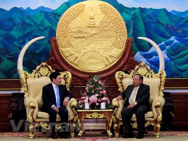 越南政府副总理兼外长范平明对老挝进行正式访问 hinh anh 1