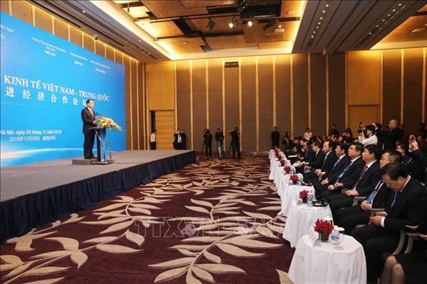 越中促进经济合作论坛在河内举行 hinh anh 1