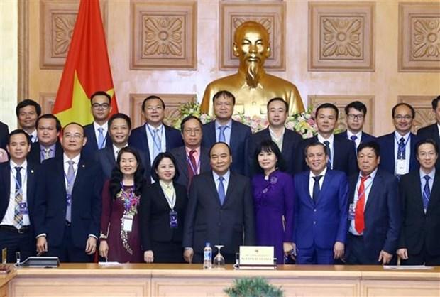 政府总理阮春福会见获得2018年国家知名品牌的企业代表 hinh anh 1