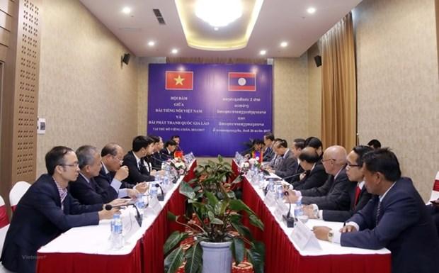 越南与老挝加强广播电视合作 hinh anh 1