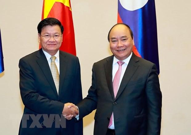 老挝总理将来越出席越老政府间合作委员会第41次会议 hinh anh 1