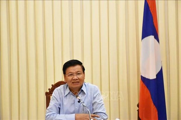 越南与老挝关系继续朝着纵深、务实方向发展 hinh anh 1