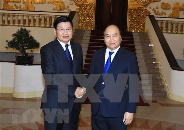 老挝总理赴越出席越老政府间合作委员会第41次会议 hinh anh 1