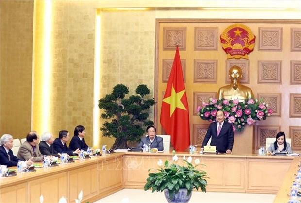 越南政府总理阮春福与越南社区保健教育协会领导会面 hinh anh 1