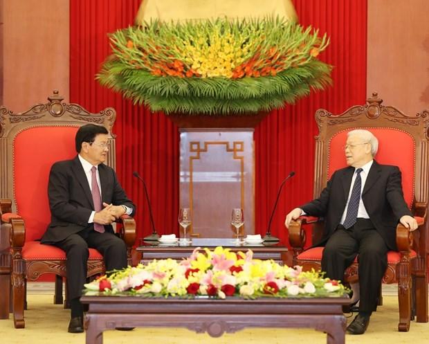 越共中央总书记、国家主席阮富仲会见老挝总理通伦 hinh anh 2