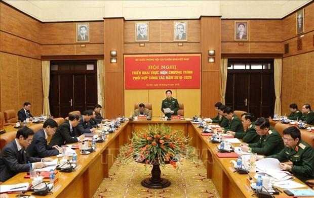 越南老兵协会中央委员会与国防部密切配合落实好国防建设任务 hinh anh 1