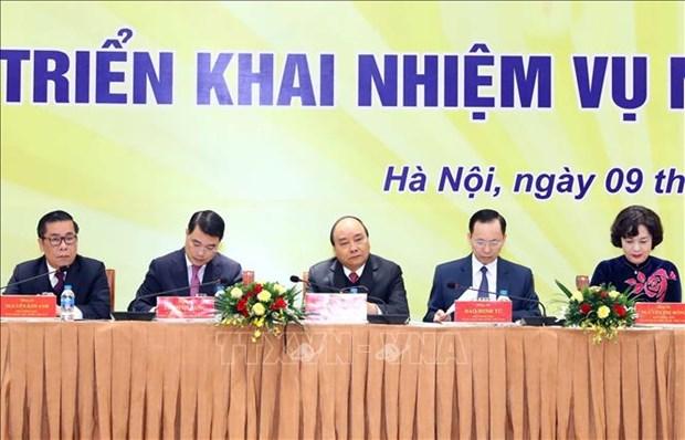 阮春福:银行在考虑经营效益的同时要承担起帮助人民的责任 hinh anh 1