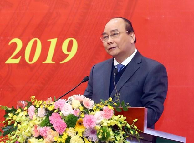 越南政府总理阮春福:群众工作必须瞄准提高人民精神和物质生活水平的目标 hinh anh 1