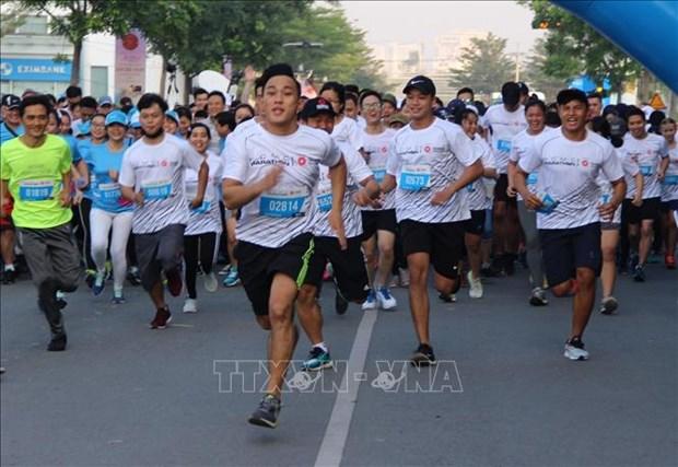 2019年胡志明市国际马拉松赛吸引9000多名运动员参加 hinh anh 1
