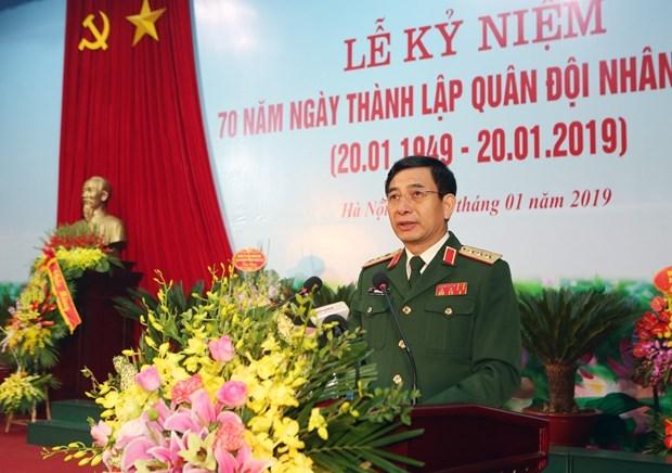 越南国防部举行老挝人民军建军70周年纪念典礼 hinh anh 2