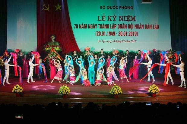 越南国防部举行老挝人民军建军70周年纪念典礼 hinh anh 1