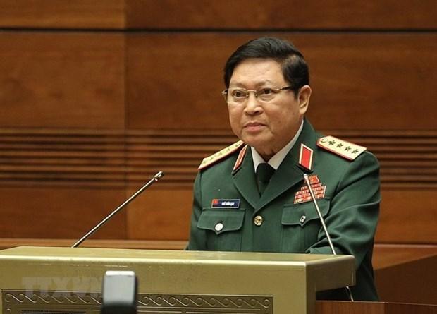 越南高级军事代表团出席老挝人民军成立70周年 hinh anh 1