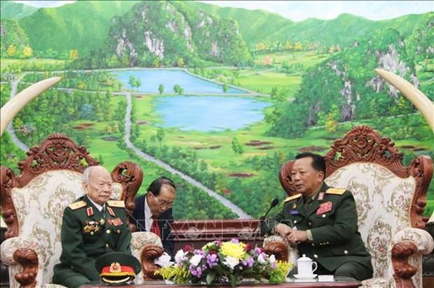 老挝国防部长感谢援老越南志愿军和专家的奉献 hinh anh 1