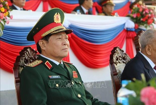 老挝隆重举行人民军建军70周年纪念集会 hinh anh 3