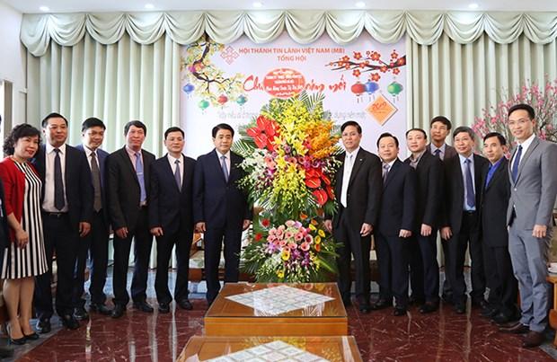 胡志明市和河内市领导人向各宗教团体拜年 hinh anh 3