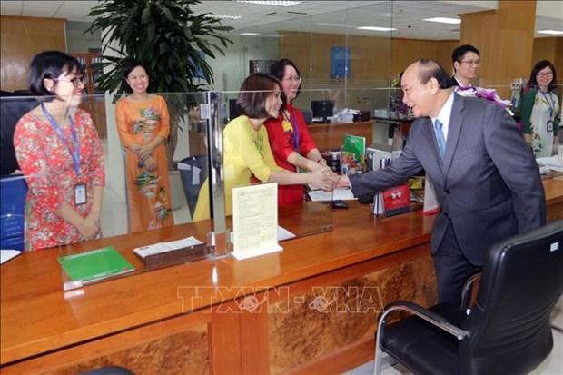 越南政府总理阮春福出席政策性银行新春交班会 hinh anh 1