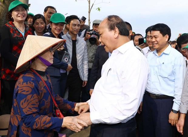 阮春福总理:打造四季花开、清洁优美的首都河内 hinh anh 3