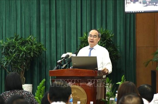 胡志明市:把人民和企业的满意度作为衡量公务员工作效率的指标 hinh anh 1