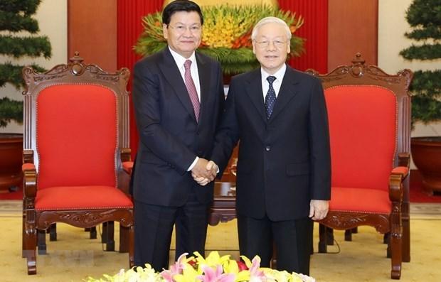 老挝媒体:阮富仲对老进行正式友好访问具有重要历史意义 hinh anh 1