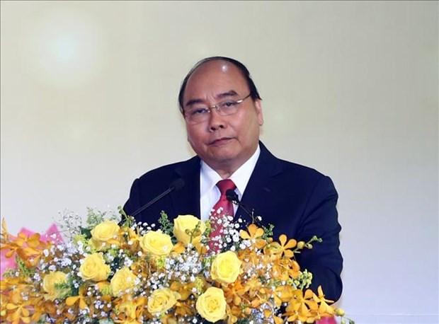 政府总理阮春福出席国内外投资商新春见面会 hinh anh 2