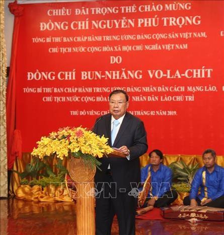老挝领导人为阮富仲一行举行招待宴会 hinh anh 2