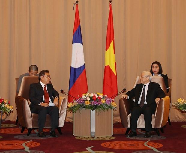 越共中央总书记、国家主席阮富仲会见老挝建国阵线中央委员会代表团 hinh anh 1