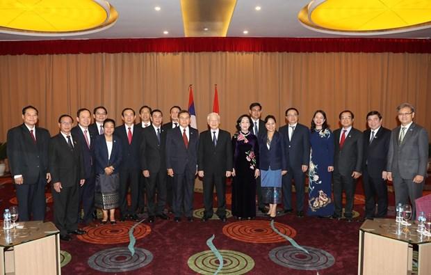 越共中央总书记、国家主席阮富仲会见老挝建国阵线中央委员会代表团 hinh anh 3
