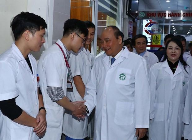 阮春福总理:医务人员队伍是默默奉献者 hinh anh 2