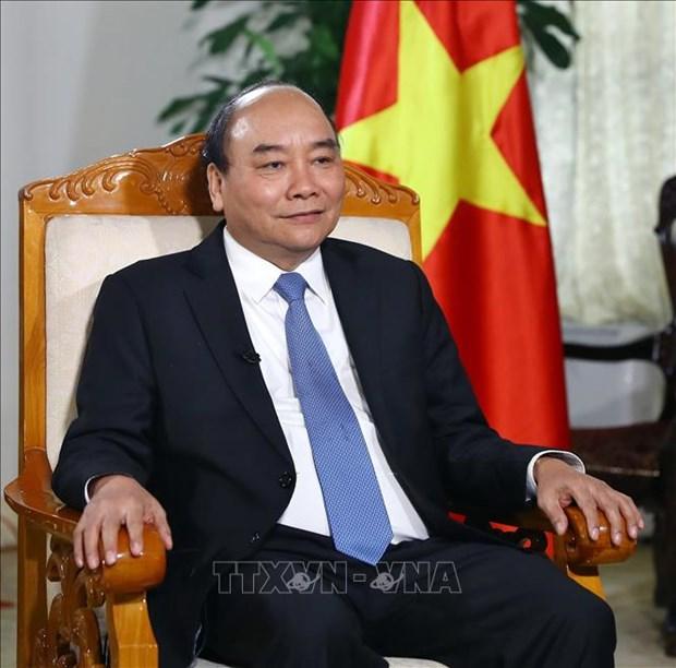 美朝领导人第二次会晤:越南政府总理阮春福回答越通社记者的采访 hinh anh 1