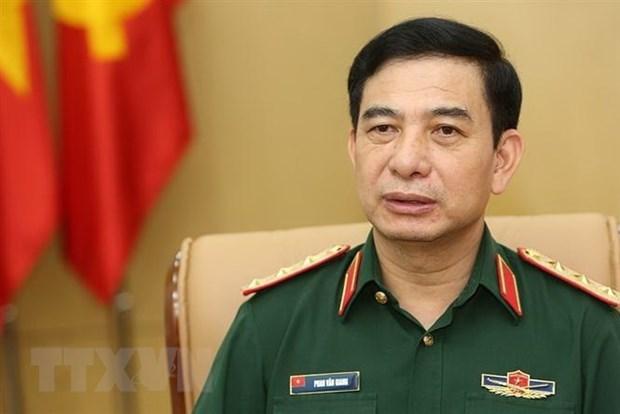 越南人民军高级军事代表团对新加坡进行正式访问 hinh anh 1