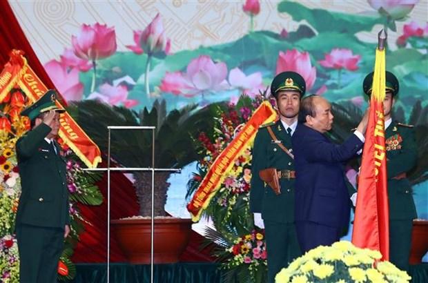 越南政府总理阮春福出席边防部队传统日60周年纪念典礼 hinh anh 1