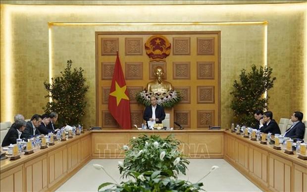 越南政府总理阮春福主持召开经济社会委员会会议 hinh anh 1