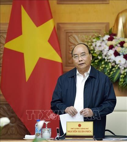 越南政府总理阮春福主持召开经济社会委员会会议 hinh anh 2