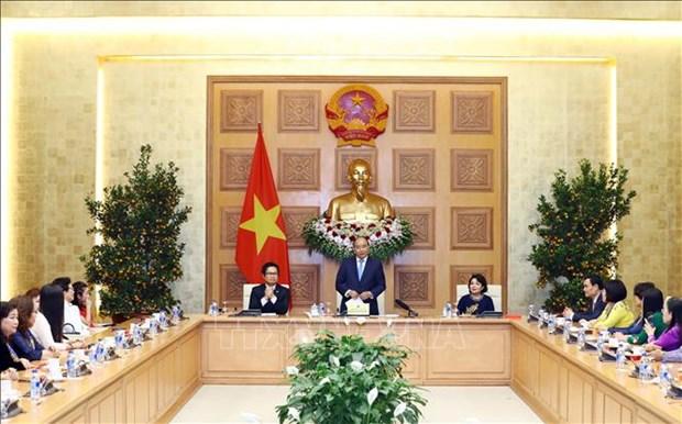 越南政府总理阮春福会见越南女企业家代表 hinh anh 1